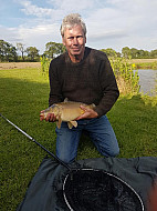 Pewitt Hall Farm pool Phil Williams with a Mirror carp