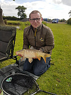 Pewitt Hall Farm pool Carl Williams with a Mirror carp
